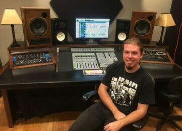 James Cross sitting at a mixing desk